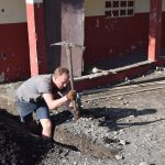 A different job: trenching for an electrical line to power one LED bulb in each classroom.