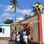 Getting the trusses onto the roof requires lots of manpower